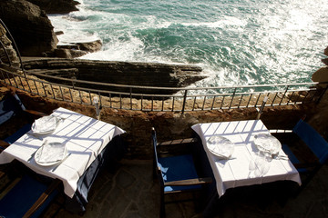 restaurant table in front of the sea to Vernazza