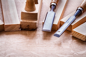 chisels and plane planks on wooden board