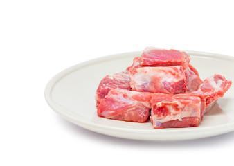 pork sparerib raw in dish isolated on white background