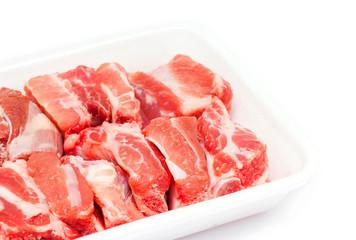 pork sparerib raw in tray foam isolated on white background