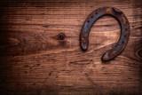 single horseshoe on vintage wooden board