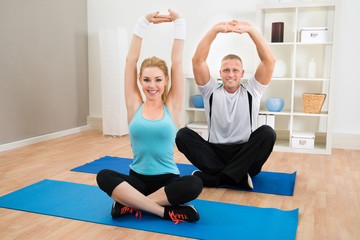 Young Couple Exercising