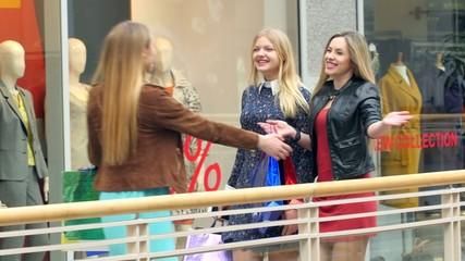 Three girls on a shopping: meeting friends.