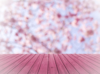 red wood over blurred, blooming trees, product display montage