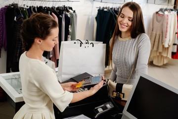 Woman buying in fashion showroom