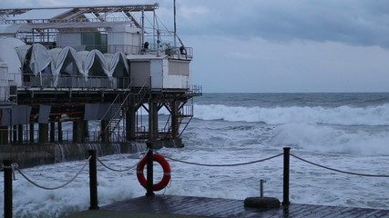 The restaurant building in the Black sea during a storm in Sochi