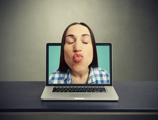 kissing woman got out of the laptop