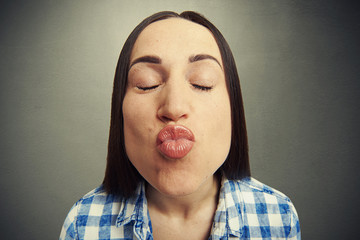 wide angle portrait of kissing woman