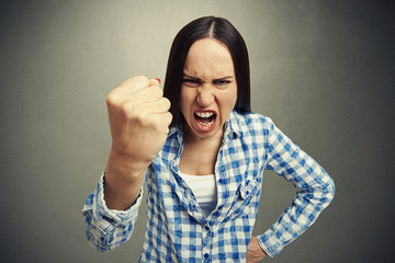 woman yelling and waving her fist