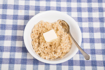 Hot Oatmeal with Butter and Spoon