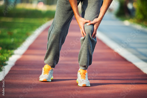 Man having pain in leg while jogging