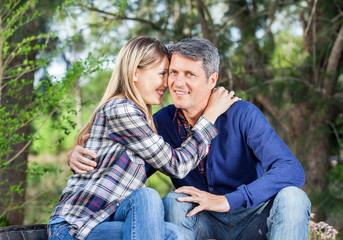 Man Embracing Girlfriend At Campsite