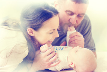 Happy family - mom, dad and their newborn baby