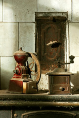 antique coffee grinders on old coal  kitchen with natural light