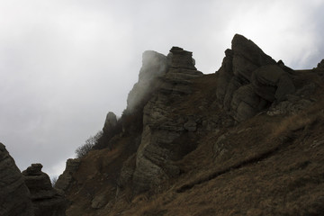 rocks on mountain in cloud