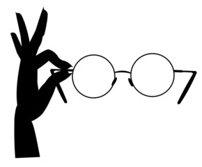 hand holding glasses in silhouette