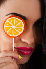 beautiful woman and a bright lollipop