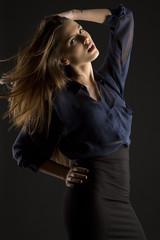 beautiful woman with brown hair in studio shooting