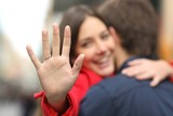 Fototapety Happy woman showing engagement ring after proposal