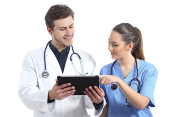 Doctor and nurse student working with a tablet