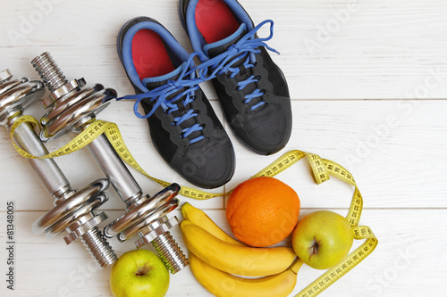 fitness equipment and healthy nutrition on white wooden plank fl
