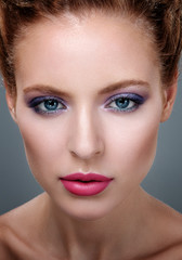 Close-up portrait of beautiful girl with bright makeup.