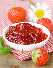 fresh strawberry jam in a white bowl on the table
