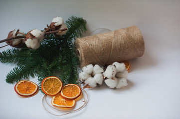 Flower design with fluffy dried cotton bolls and jute rope hank