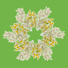 A wreath of leaves on green