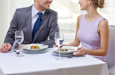 close up of couple talking at restaurant