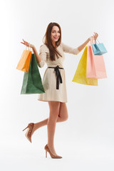 Happy Woman With a Shopping Bags. Isolated on white.