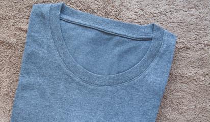 Black men t-shirt on brown towel background
