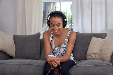 woman headphones cellphone