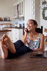 woman relaxing cellphone