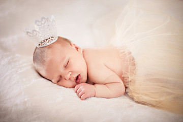 Newborn sleeping princess with crown