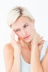 Pretty blonde suffering from neck ache