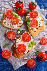 Sandwich with cheese, tomato and Basil