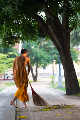 thai monk daily cleaning temple area