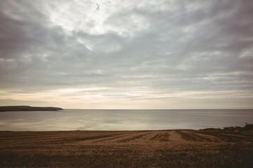 Grey sky over expansive ocean