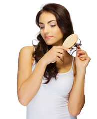 Young girl with hair brush