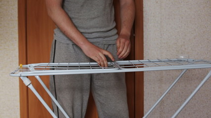 guy lays clothes dryer CU