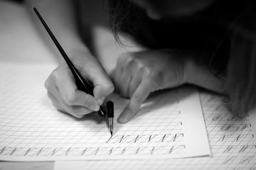 Woman studying hard calligraphy