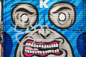 Angry masked man graffiti