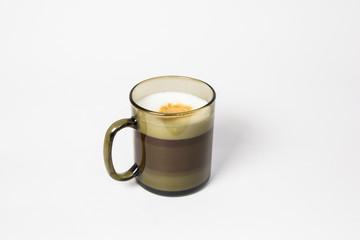 Puff coffee of Latte Macchiato in a black mug