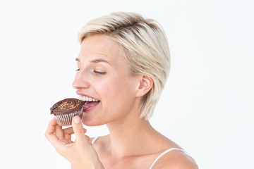 Attractive woman eating muffin