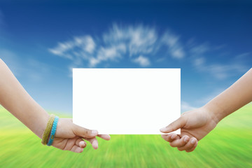Two children holding a white paper background nature.