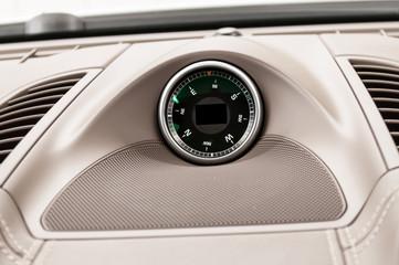 Car dashboard compass. Interior detail.