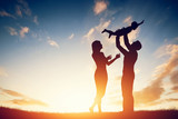 Happy family together, parents with their little baby at sunset poster