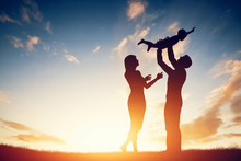 "Постер, картина, фотообои ""Happy family together, parents with their little baby at sunset"""