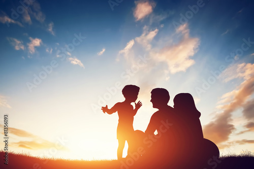 Happy family together, parents with their child at sunset. - 81356093